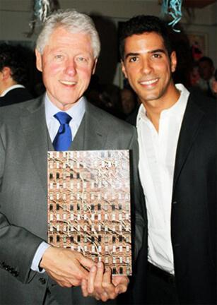 President Bill Clinton receiving Javier Gomez signed photograph